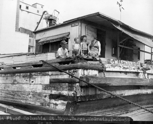 Family aboard their house barge, the G.W. LETHBRIDGE: 1939